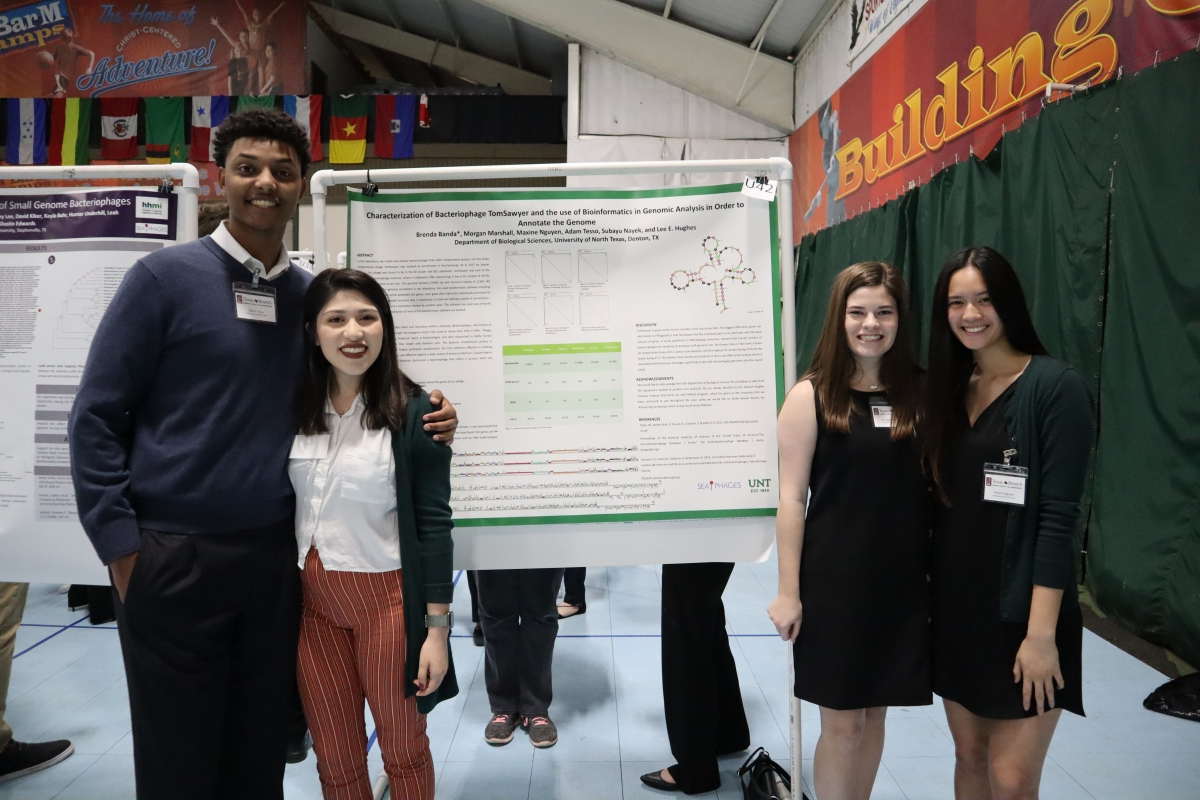UNT PHAGES students presenting poster at state microbiology conference.
